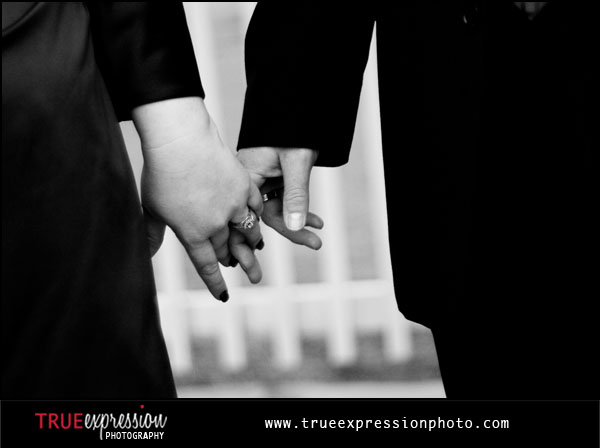 close-up photo of bride and groom holding hands by Kelly LaBruyere