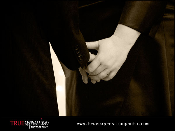 close-up photo of bride and groom holding hands by Atlanta wedding photographer Kelly LaBruyere