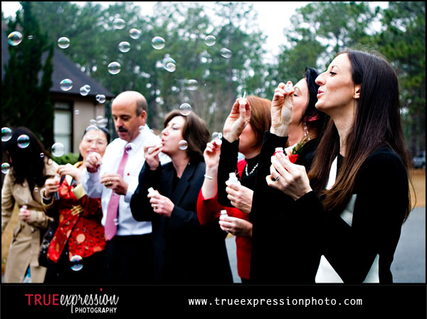wedding guests blowing bubbles