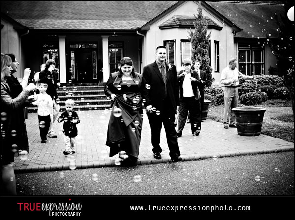 wedding photograph of the bride and groom leaving the wedding reception