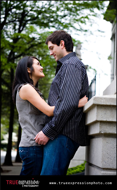 engagement photo of a couple looking at each other in Midtown atlanta