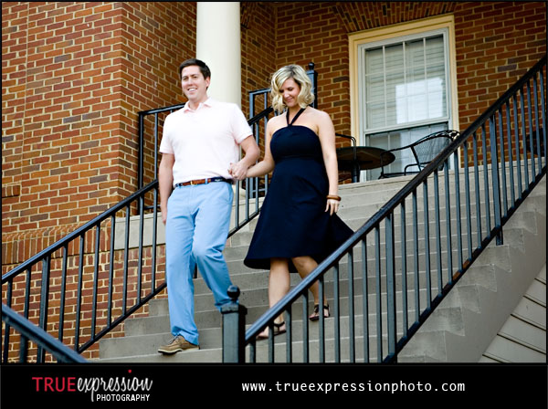 couple walking down the stairs entering the rehearsal dinner