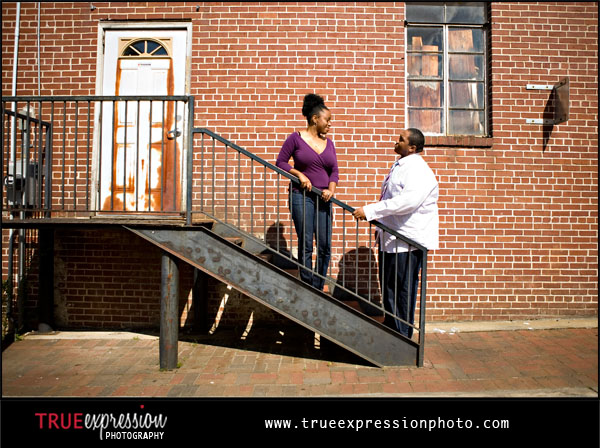 engagement photos in front of a brick wall in Marietta GA