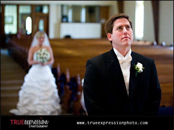 groom waiting as bride walks down the aisle