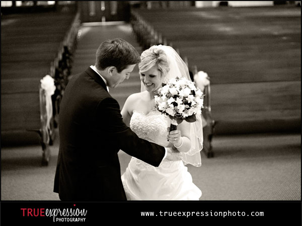 photo of bride and groom in church by Atlanta wedding photographer Kelly LaBruyere