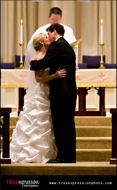 bride and groom's first kiss; wedding at Kennesaw United Methodist Church
