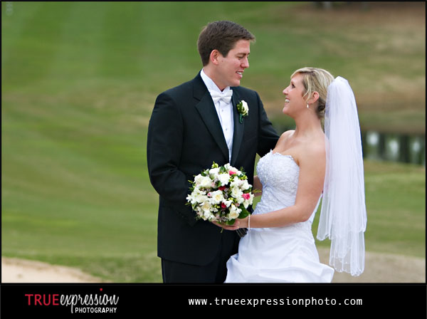 wedding photograph of bride and groom on a golf course