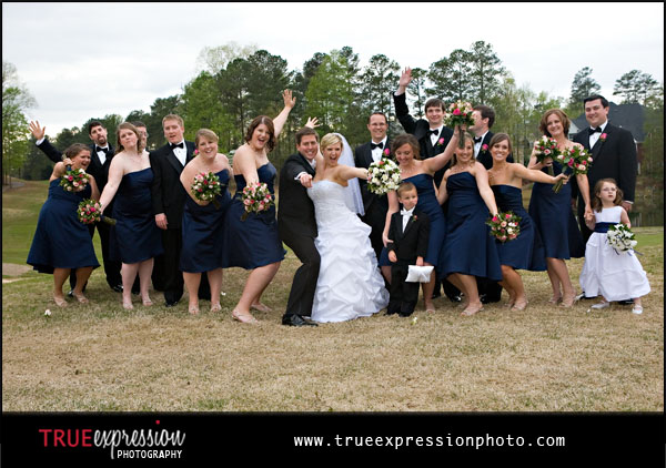 fun photo of the wedding party on the golf course at Brookstone Country Club