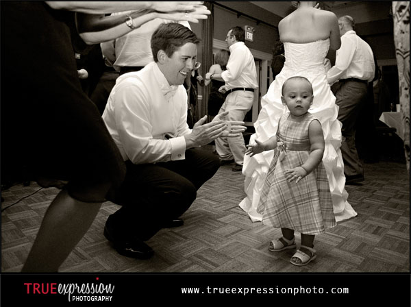 groom and little girl dancing