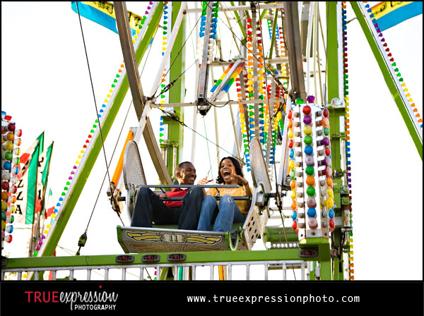 engagement photo of couple of ferris wheel