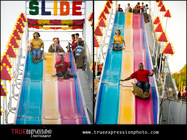 couple going down fun slide at the carnival