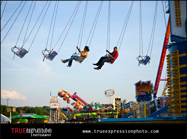 engagement photo at a carnival by Atlanta wedding photographer Kelly LaBruyere