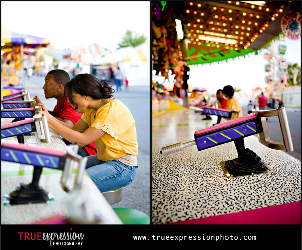 photo of couple playing carnival games