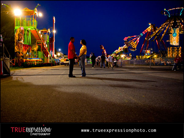 engagement photo session of a couple at carnival