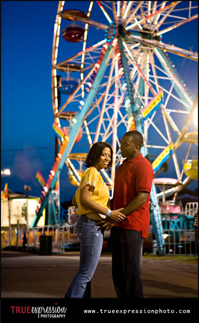 engagement photo taken in front of a ferris wheel by Atlanta wedding photographer Kelly LaBruyere