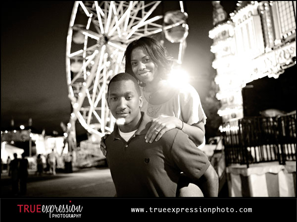 black and white photo of a couple at a carnival in Marietta GA