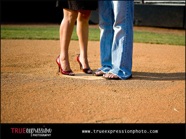 couple standing on home plate