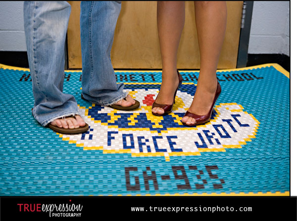 photo of couple's feet standing on an ROTC mat