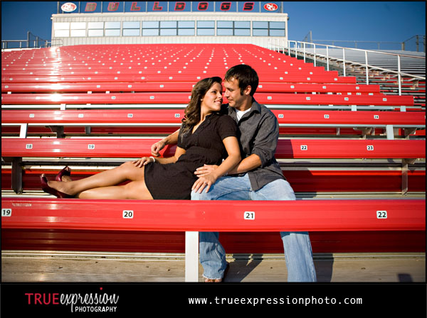 engagement photo in a football stadium