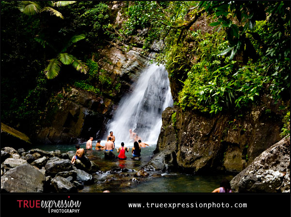 people swimming under La Mina Falls