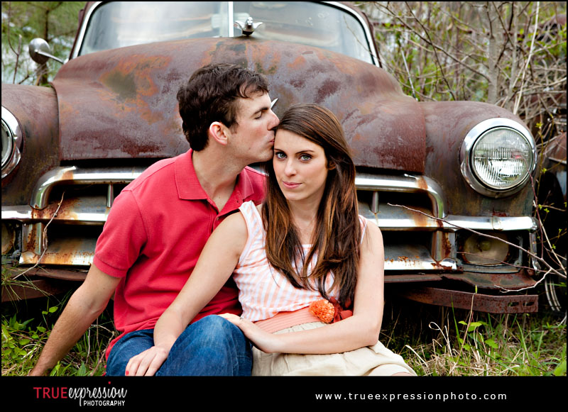 engagement photo in front of an old car